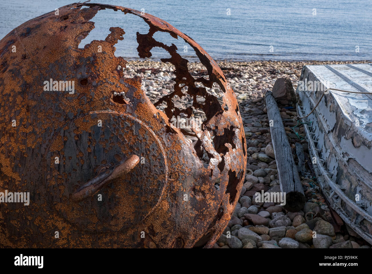 Rusty buoy on the beach at Polbain, north of Ullapool, on the west coast of Scotland. - Stock Image