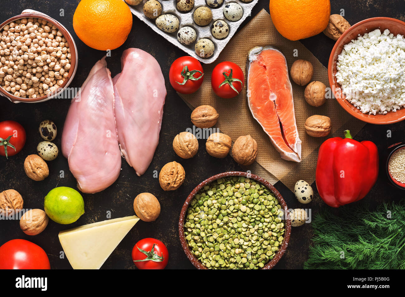 Balanced dietary products. The concept of healthy eating. Background of a healthy meal. Fruits, vegetables, salmon, chicken fillet, cereals. The view from above, flat lay. Stock Photo