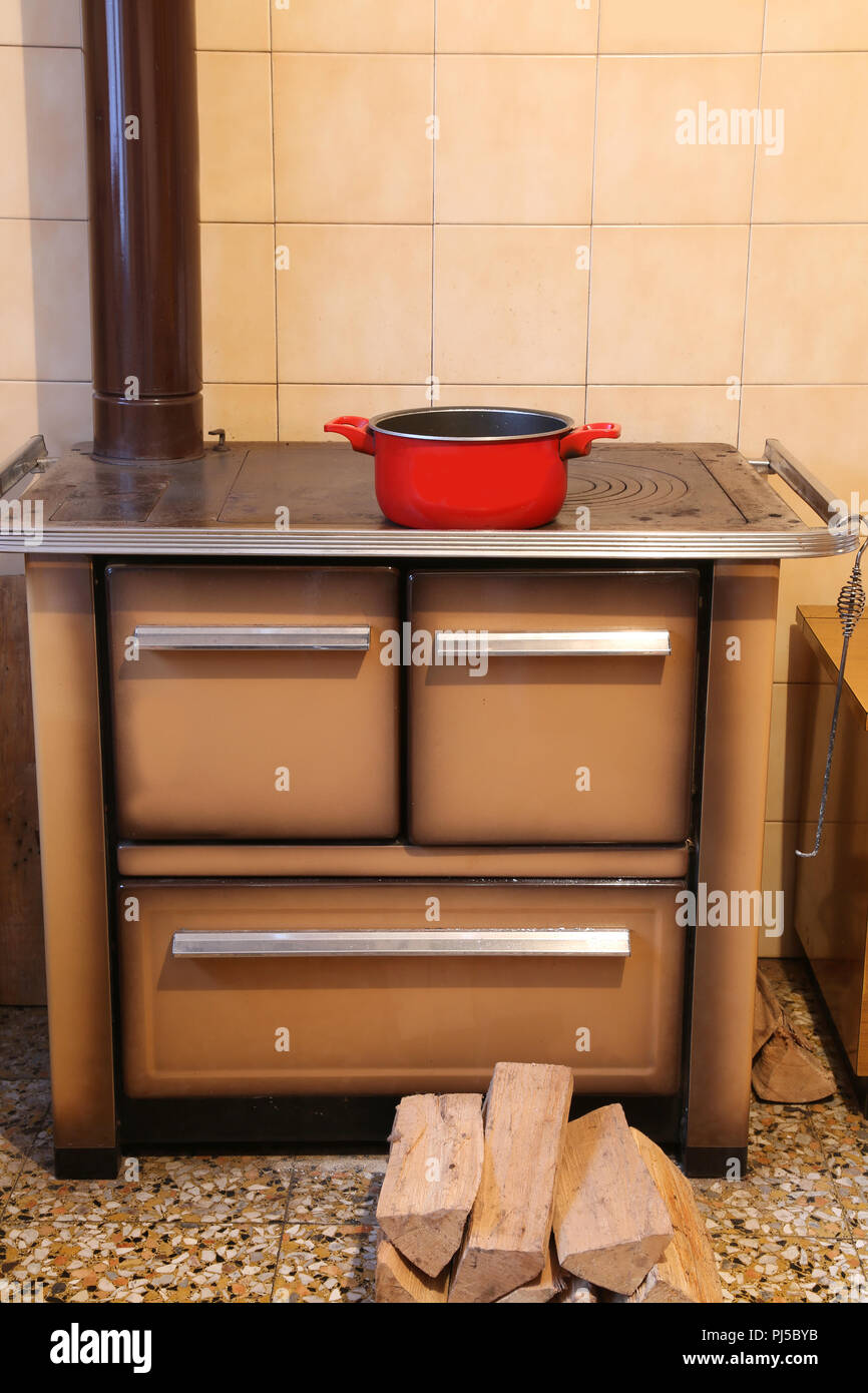 Ancient Wood Burning Stove In The Kitchen Of The Small House With A