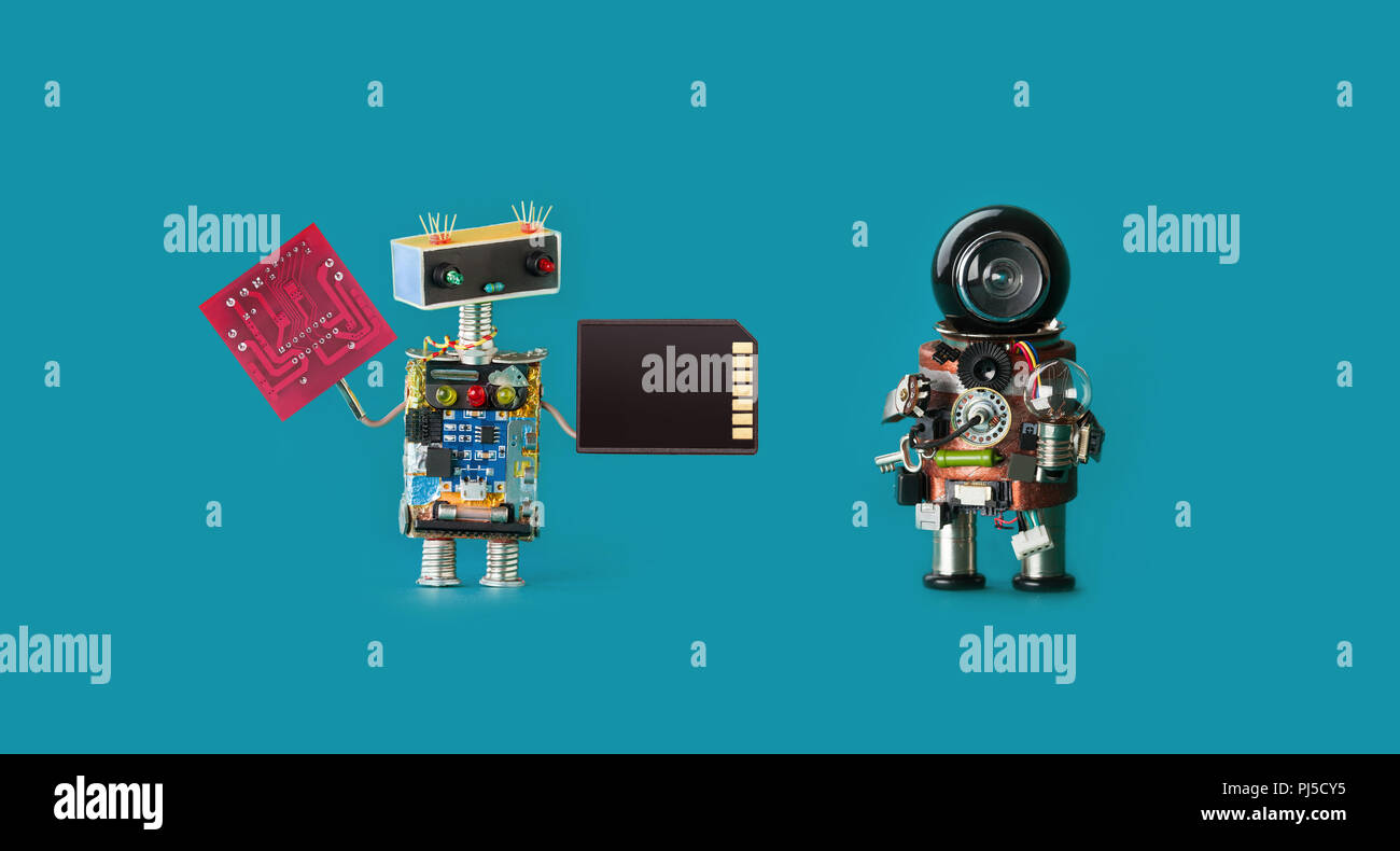 Robotics 4.0 industrial revolution concept. Two robots with circuit board memory card and light bulb on virid color background. Isolated - Stock Image