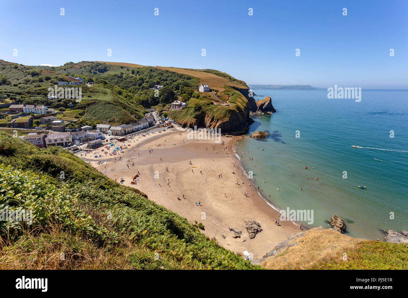 Looking down onto Llangrannog beach from the cliff path, on a warm summers day. Ceredigion, Wales - Stock Image