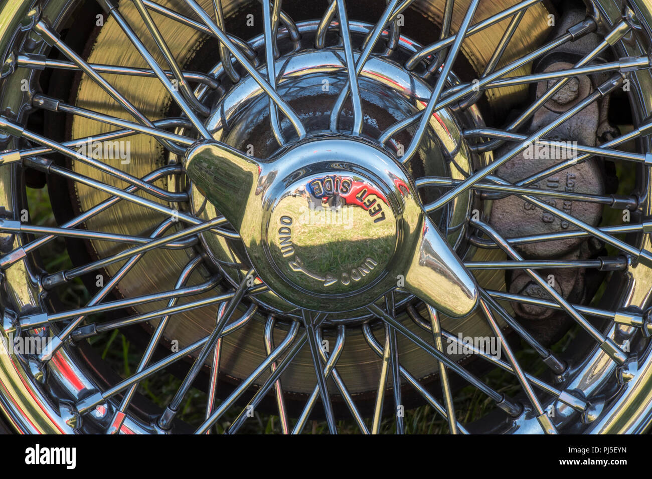vintage sports car chromed spoked wheel with spinner and disc brakes