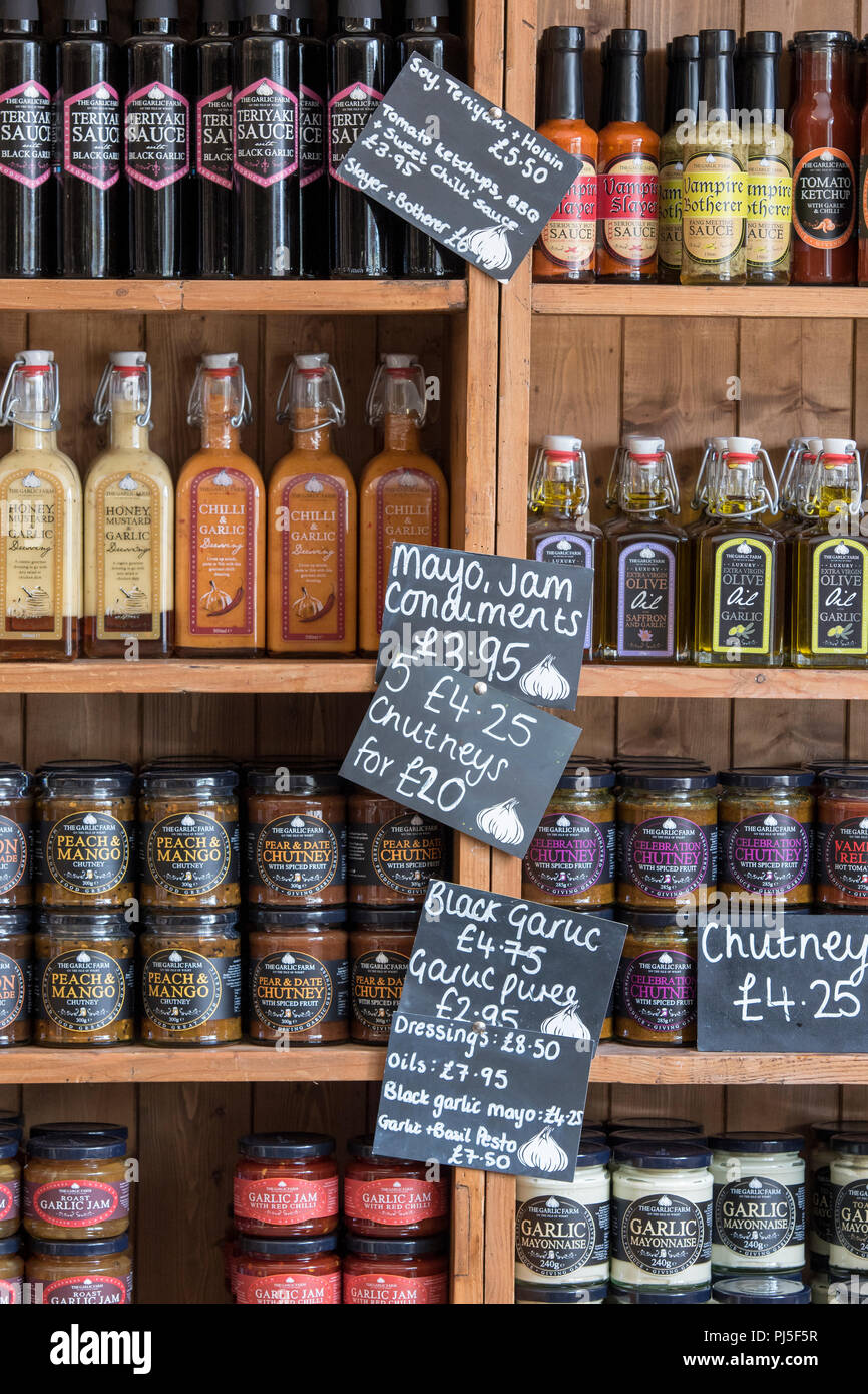 a selection of home made chutney and sauces on sale and display at the garlic farm on the isle of wight. - Stock Image