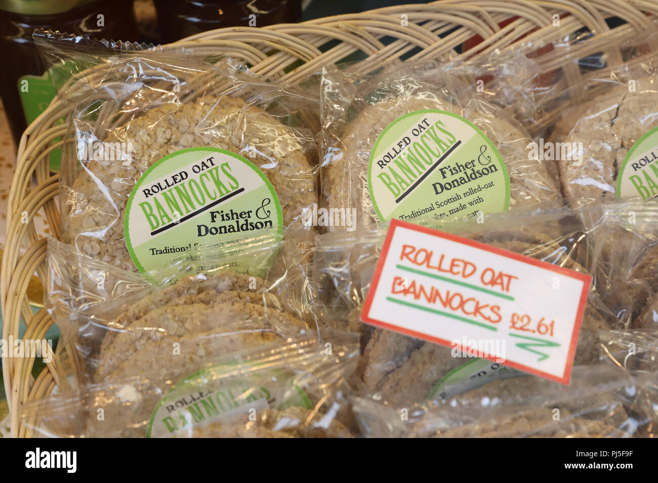 Traditional Scottish fare in the window of Fisher and Donaldson Royal appointed bakery and cafe on Whitehall Street, in Dundee, UK - Stock Image