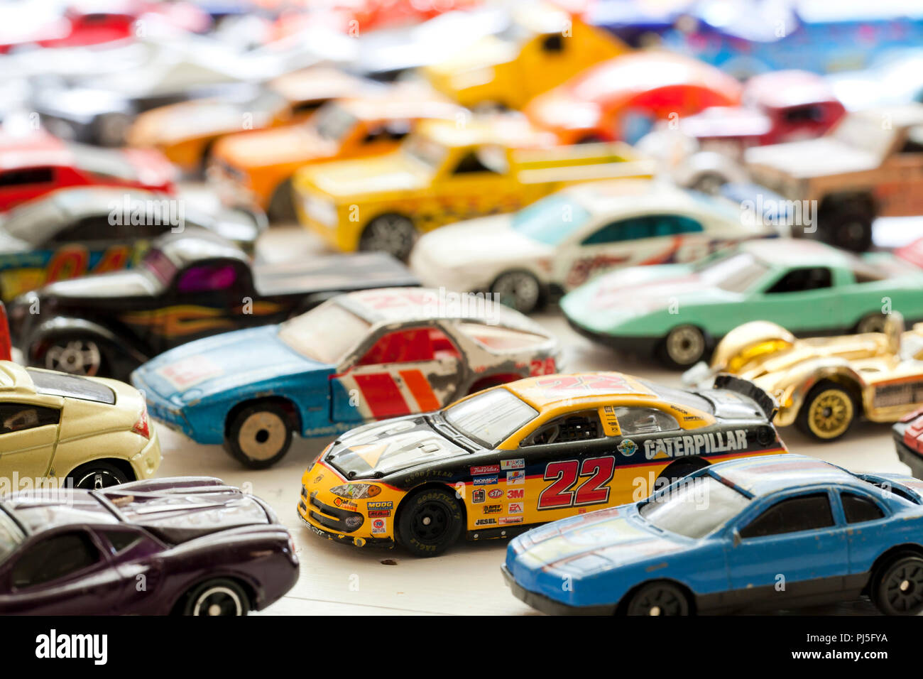 Vintage used Hot Wheels collection on table - USA - Stock Image
