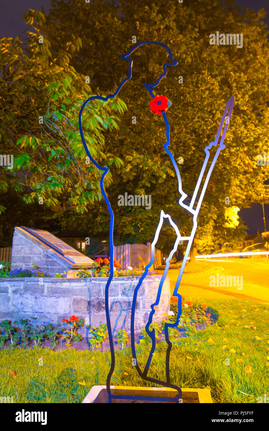 A Tommy silhouette figure in Scholes, which has been installed to remember the fallen from World War 1. - Stock Image