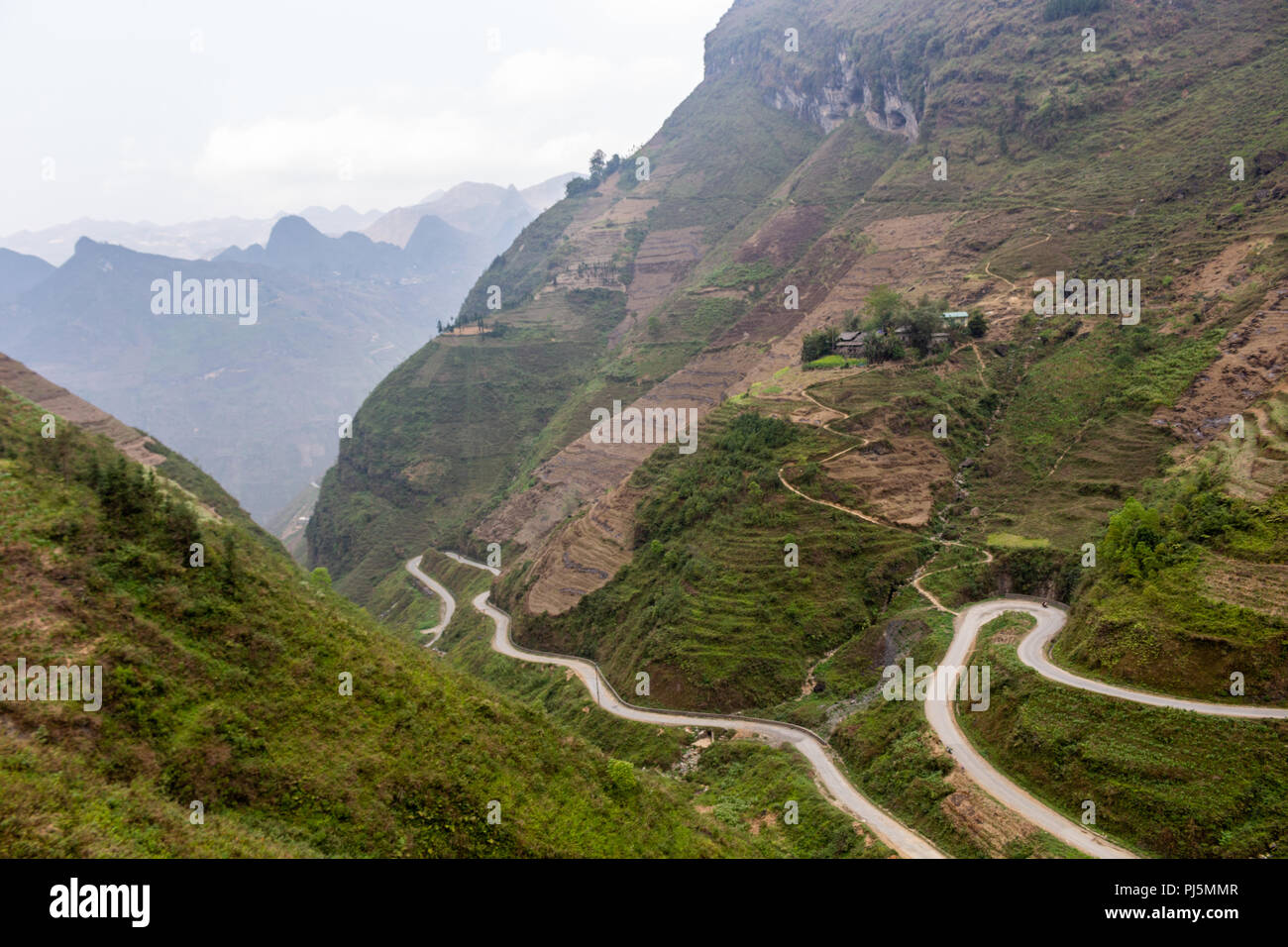 Ha Giang, Vietnam - March 18, 2018: Stunning view of terraced land and high mountains at Ma Pi Leng pass, one of the most dangerous roads of Vietnam Stock Photo