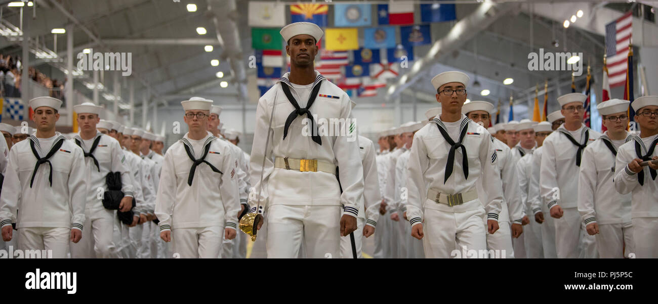 180817-N-PL946-1083 GREAT LAKES, Ill. (Aug. 17, 2018) U.S. Navy Sailors graduate from boot camp at Recruit Training Command (RTC). More than 30,000 recruits graduate annually from the Navy's only boot camp. (U.S. Navy photo by Communication Specialist 2nd Class Spencer Fling) - Stock Image