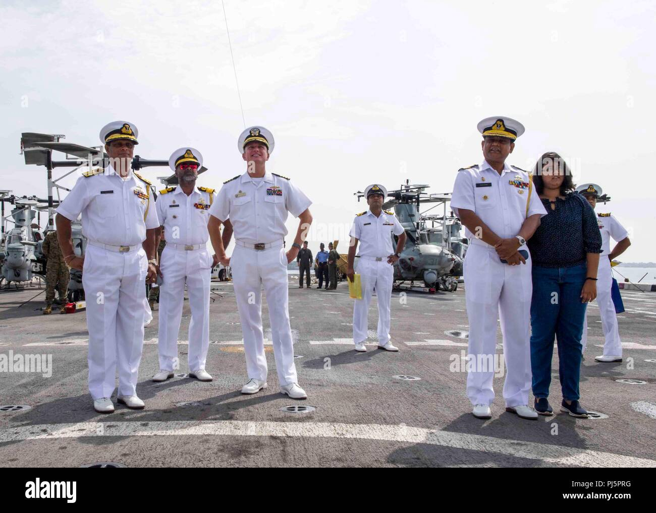 180825-N-PH222-0293 TRINCOMALEE, SRI LANKA (Aug. 25, 2018) Capt. Dennis Jacko, commanding officer of San Antonio-class amphibious transport dock USS Anchorage (LPD 23), from Sayreville, N.J., right, gives a tour to distinguished visitors of the Sri Lanka navy during a regularly scheduled deployment of the Essex Amphibious Ready Group (ARG) and 13th Marine Expeditionary Unit (MEU). Anchorage and the embarked Marines of the 13th MEU are conducting a theater security cooperation exercise with the Sri Lankan navy and marines. Part of a growing U.S.-Sri Lanka naval partnership, the exercise is also - Stock Image