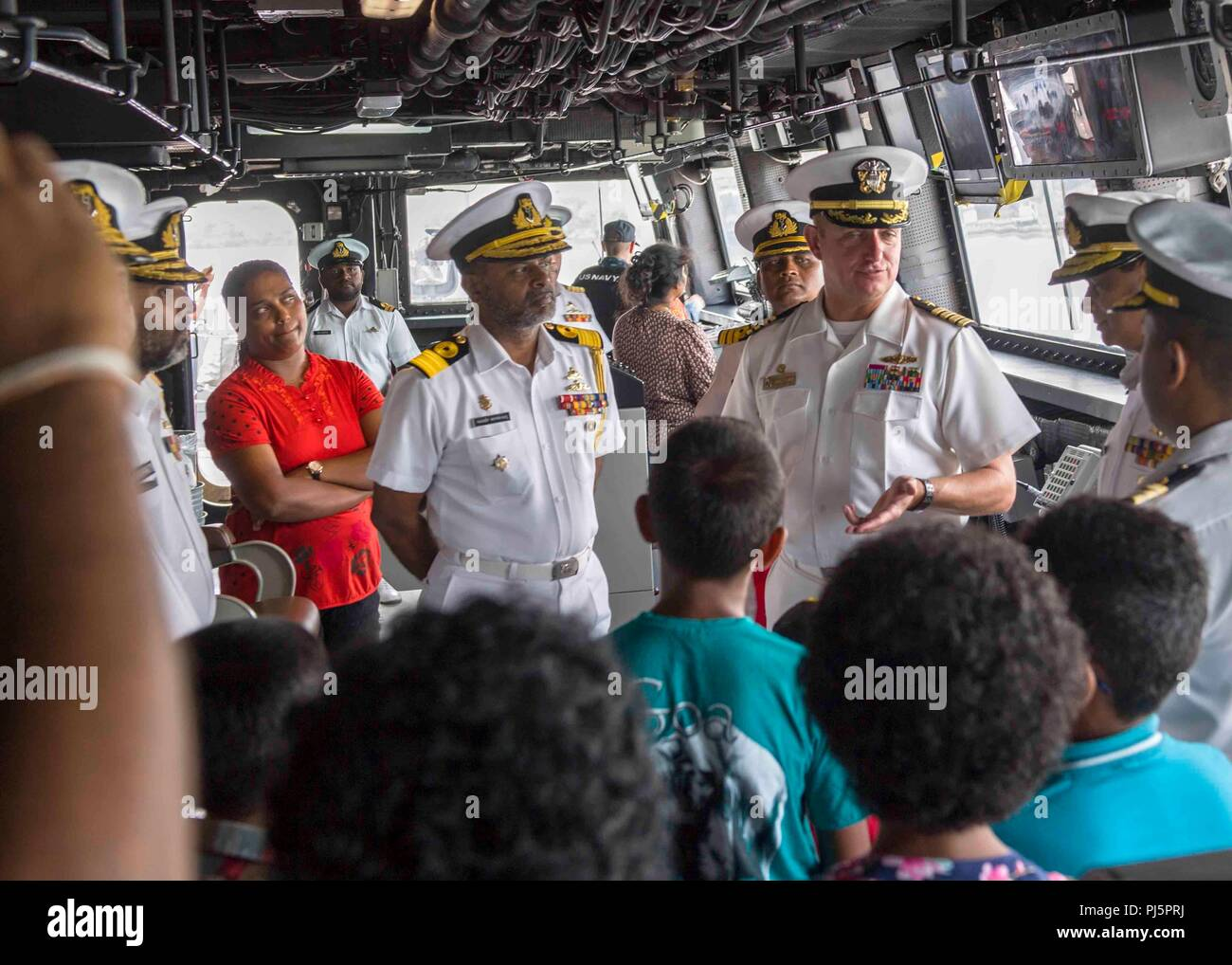 180825-N-PH222-0393 TRINCOMALEE, SRI LANKA (Aug. 25, 2018) Capt. Dennis Jacko, commanding officer of San Antonio-class amphibious transport dock USS Anchorage (LPD 23), from Sayreville, N.J., gives a tour to distinguished visitors of the Sri Lanka navy and their families during a regularly scheduled deployment of the Essex Amphibious Ready Group (ARG) and 13th Marine Expeditionary Unit (MEU). Anchorage and the embarked Marines of the 13th MEU are conducting a theater security cooperation exercise with the Sri Lankan navy and marines. Part of a growing U.S.-Sri Lanka naval partnership, the exer - Stock Image
