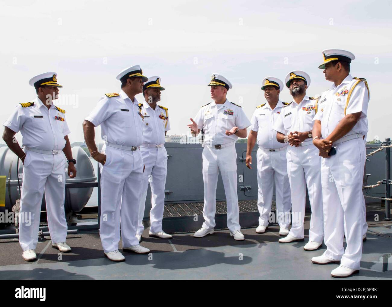 180825-N-PH222-0404 TRINCOMALEE, SRI LANKA (Aug. 25, 2018) Capt. Dennis Jacko, commanding officer of San Antonio-class amphibious transport dock USS Anchorage (LPD 23), from Sayreville, N.J., gives a tour to distinguished visitors of the Sri Lanka navy during a regularly scheduled deployment of the Essex Amphibious Ready Group (ARG) and 13th Marine Expeditionary Unit (MEU). Anchorage and the embarked Marines of the 13th MEU are conducting a theater security cooperation exercise with the Sri Lankan navy and marines. Part of a growing U.S.-Sri Lanka naval partnership, the exercise is also an opp - Stock Image