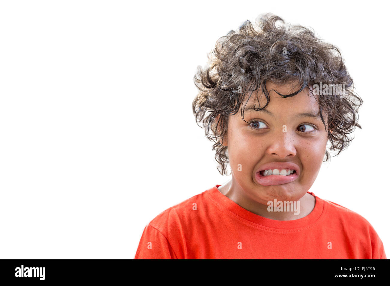 portrait of young grimacing boy isolated on white background - Stock Image