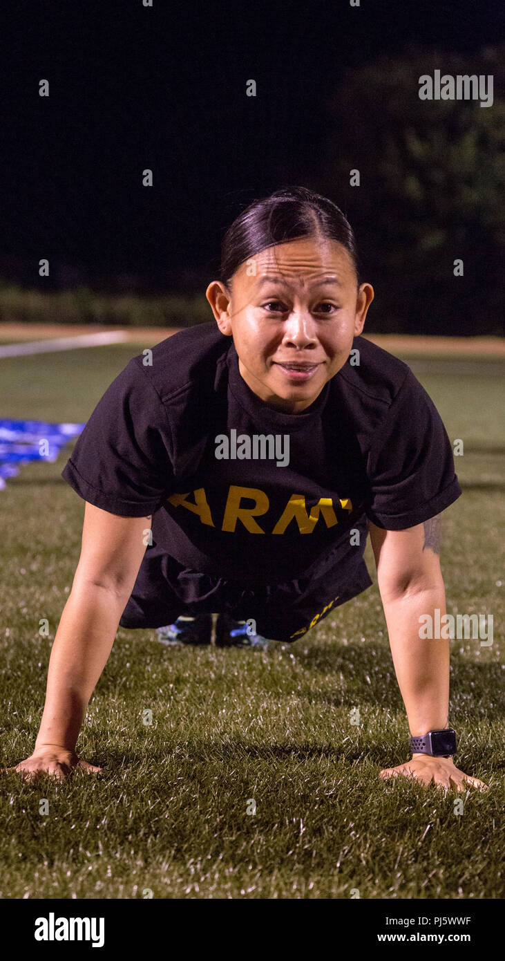 U.S. Army Drill Sgt. Lyra Lebron-Brown, a competitor in the Drill Sergeant Of The Year Competition, completes the push-up event of the Army Physical Fitness Test at Hellcat Field on Fort Sill, OK., Aug. 27, 2018. The Drill Sergeant Of The Year Competition is one of the most physically demanding and mentally tough challenges any Soldier can face in a U.S. Army competition. (U.S. Army photo by Pfc. Joshua Hugley) Stock Photo