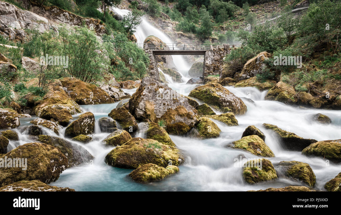 Bridge over water flowing from the Briksdal glacier in Jostedalsbreen National Park, Norway Stock Photo