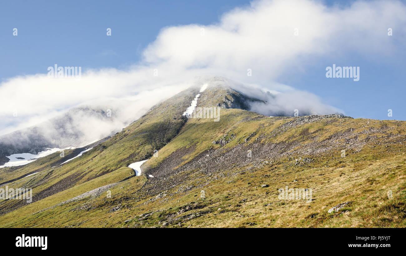The peak of Saudehornet as seen from the peak of Vallahornet. Ørsta, Norway - Stock Image
