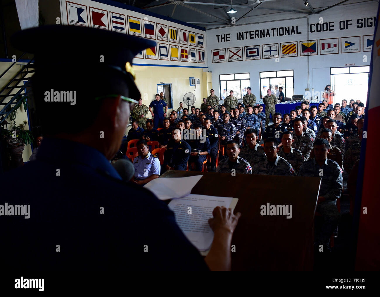 180831-N-QV906-0064 MANILA, Philippines (August 31, 2018) Commodore Joseph Badajos, acting commander, Philippine Coast Guard Surface Forces, delivers remarks during the closing ceremony for the VBSS-Workshop portion of Southeast Asia Cooperation and Training (SEACAT) 2018 aboard Philippine Coast Guard Headquarters in Manila, Philippines. This is the 17th annual SEACAT exercise and includes participants from the U.S., Brunei, Bangladesh, Thailand, Philippines, Singapore, Vietnam, Malaysia and Indonesia. (U.S. photo by Mass Communication Specialist 1st Class Micah Blechner/RELEASED) - Stock Image