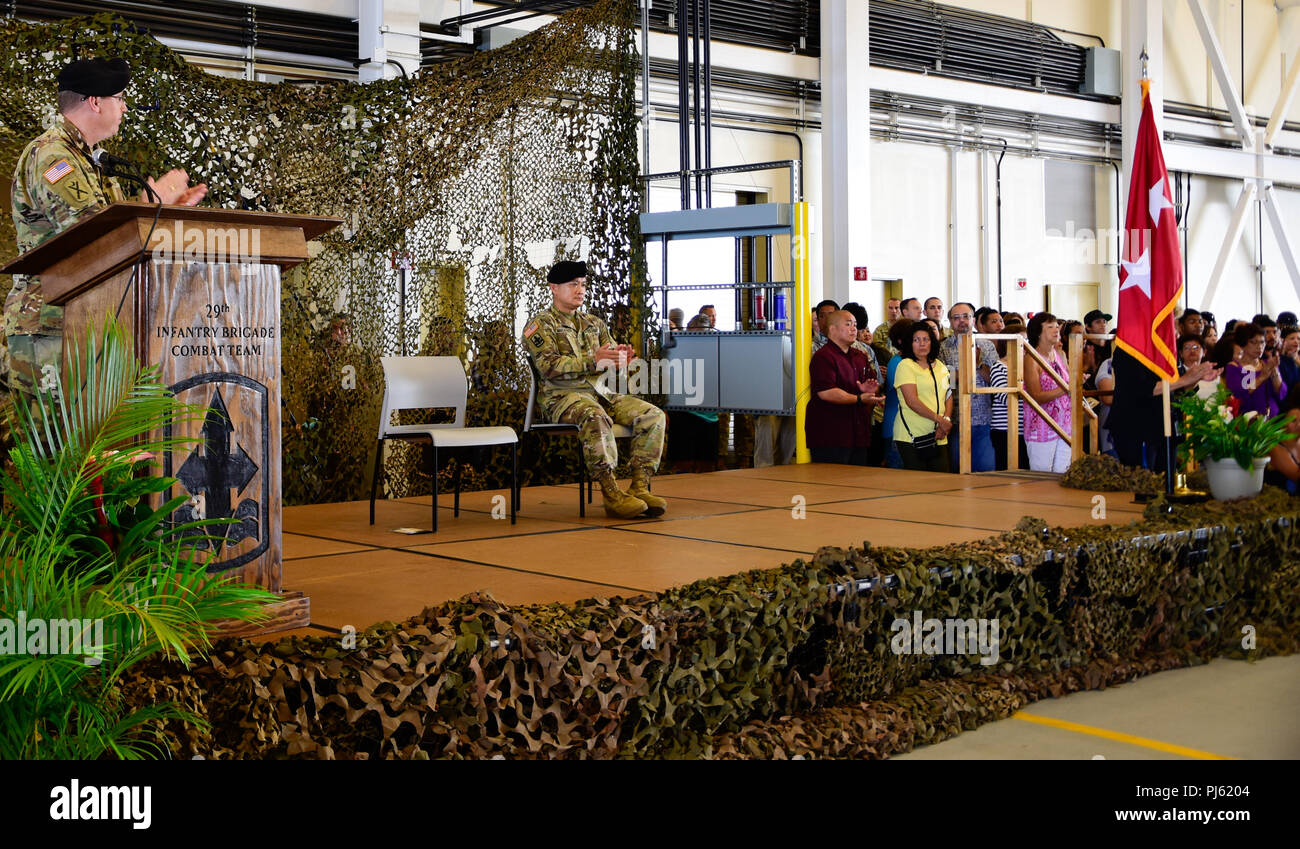 Maj. Gen. Arthur J. Logan, the Hawaii Army National Guard Adjutant General applaud Soldiers from Alpha and Bravo Troops, 1st Squadron, 299th Cavalry Regiment, and elements of the 29th Infantry Brigade Combat Team, both from the Hawaii Army National Guard for their service during their deployment ceremony at the Kalaeloa Army Aviation Support Facility on August 26, 2018. The 1-299th CAV will be deploying to Sinai, Egypt supporting the Multinational Force and Observers while the 29th IBCT will be deploying to Kosovo in support of Multinational Battle Group EastKosovo Forces (KFOR). (U.S. Army N Stock Photo
