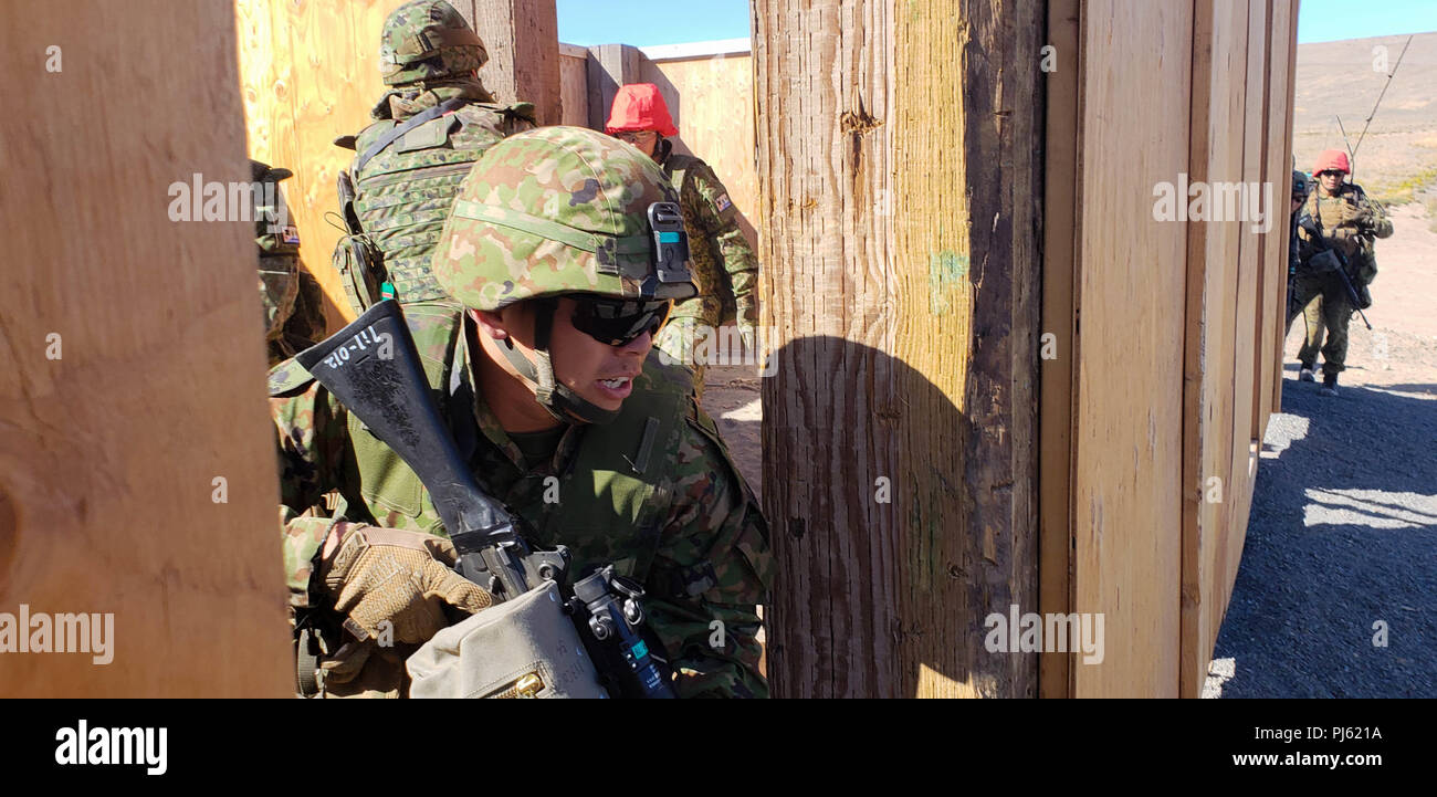 A Soldier from the 1st Infantry Regiment, Japanese Ground Self Defense Force, prepares to exit a room cleared by his squad during an Urban Live Fire training event as part of Exercise Rising Thunder 18 at the Yakima Training Center, WA, Sept. 2. This exercise allows the JGSDF to work on both individual and collective tasks at our premiere training facilities. - Stock Image