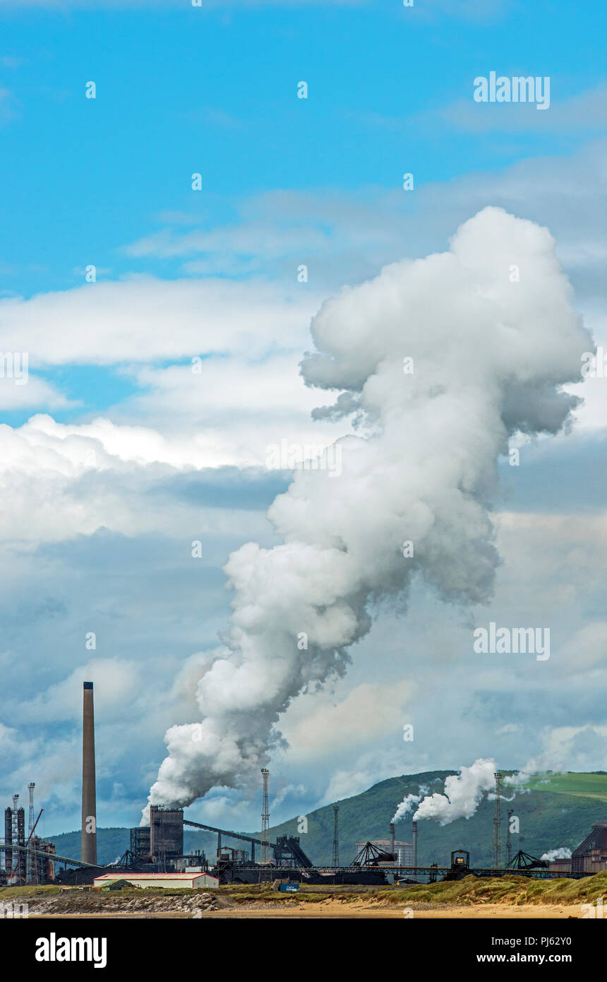 Port Talbot Steel Works emitting billowing steam which it does at timed intervals Stock Photo