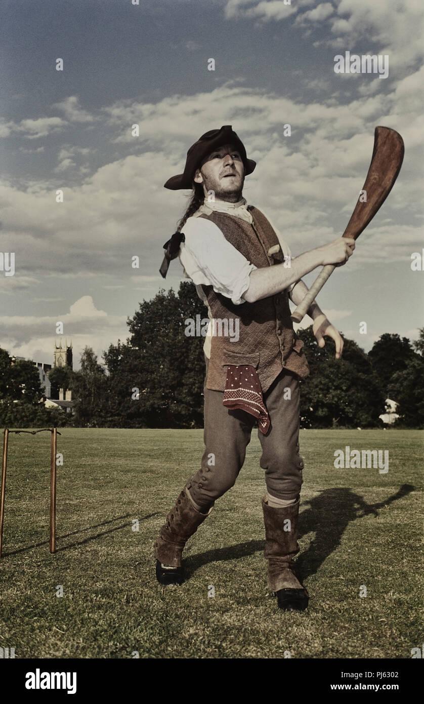 Cricket batsman dressed in 18th century period costume, England, UK - Stock Image
