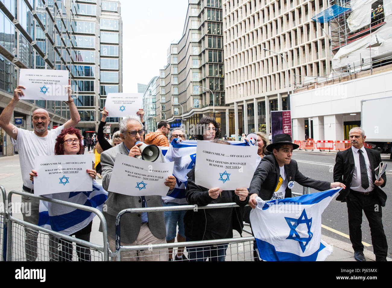 London, UK. 4th September, 2018. A group of around ten anti-Corbyn Jewish activists holds a counter-protest against supporters of Jeremy Corbyn from Jewish Voice for Labour, Momentum and other groups campaigning outside the headquarters of the Labour Party on the day on which the party NEC was expected to adopt the IHRA definition and examples of anti-Semitism. Credit: Mark Kerrison/Alamy Live News Stock Photo