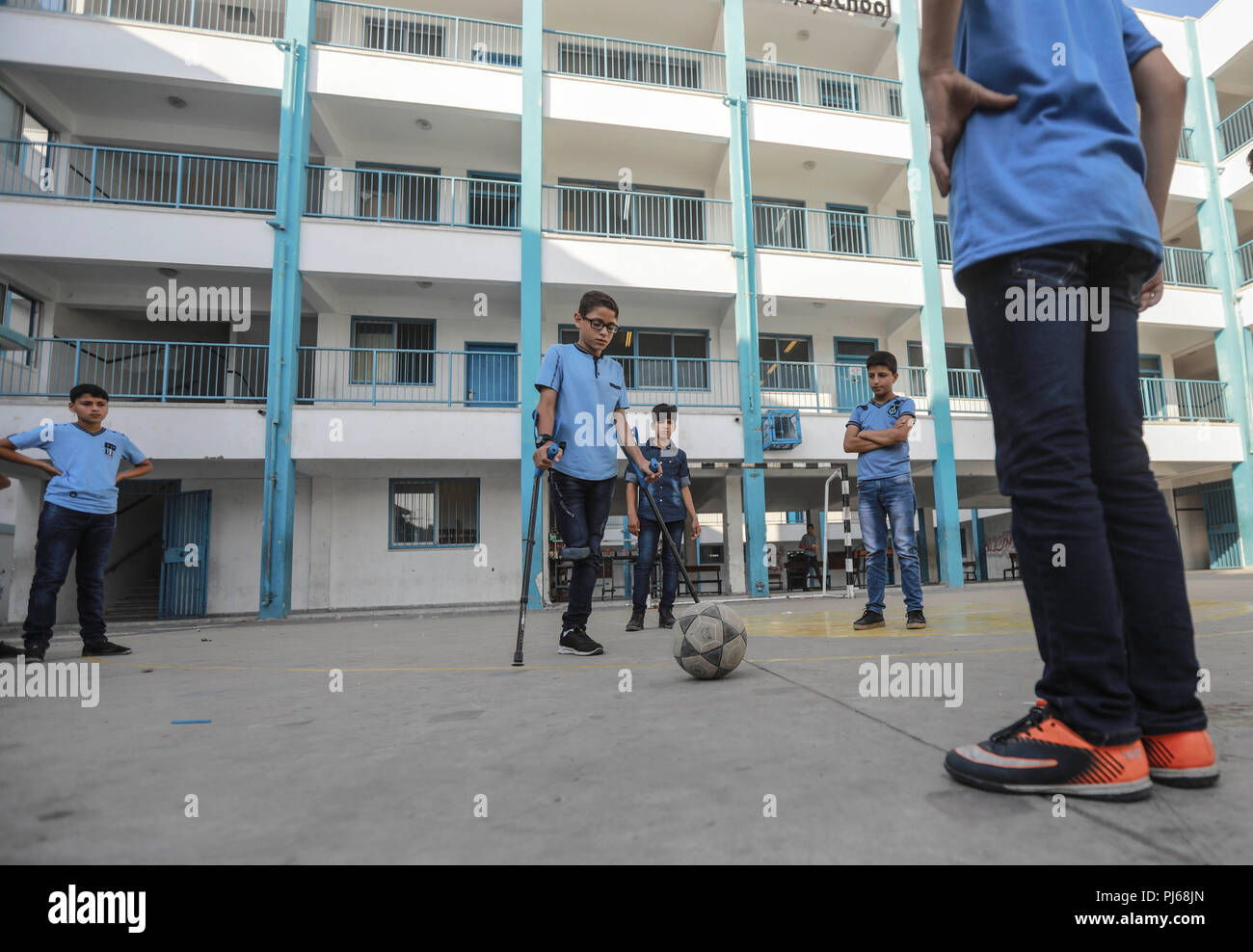 Gaza. 4th Sep, 2018. Students play soccer at Jabalia School for Refugees in northern Gaza Strip, on Sept. 4, 2018. Palestinian President Mahmoud Abbas said Sunday that the question of the Palestinian refugees has to be resolved in accordance with the legitimate international resolutions. Credit: Wissam Nassar/Xinhua/Alamy Live News - Stock Image