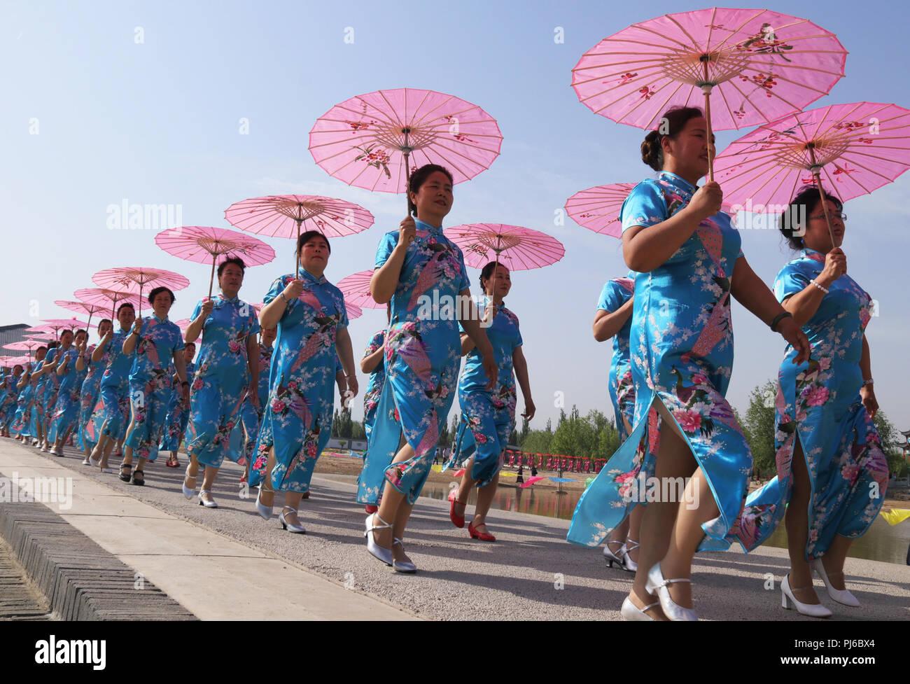 Zhangjiakou, Zhangjiakou, China. 5th Sep, 2018. Zhangjiakou, CHINA-Women present various cheongsams at a cheongsam show held in Zhangjiakou, north China's Hebei Province. Credit: SIPA Asia/ZUMA Wire/Alamy Live News - Stock Image