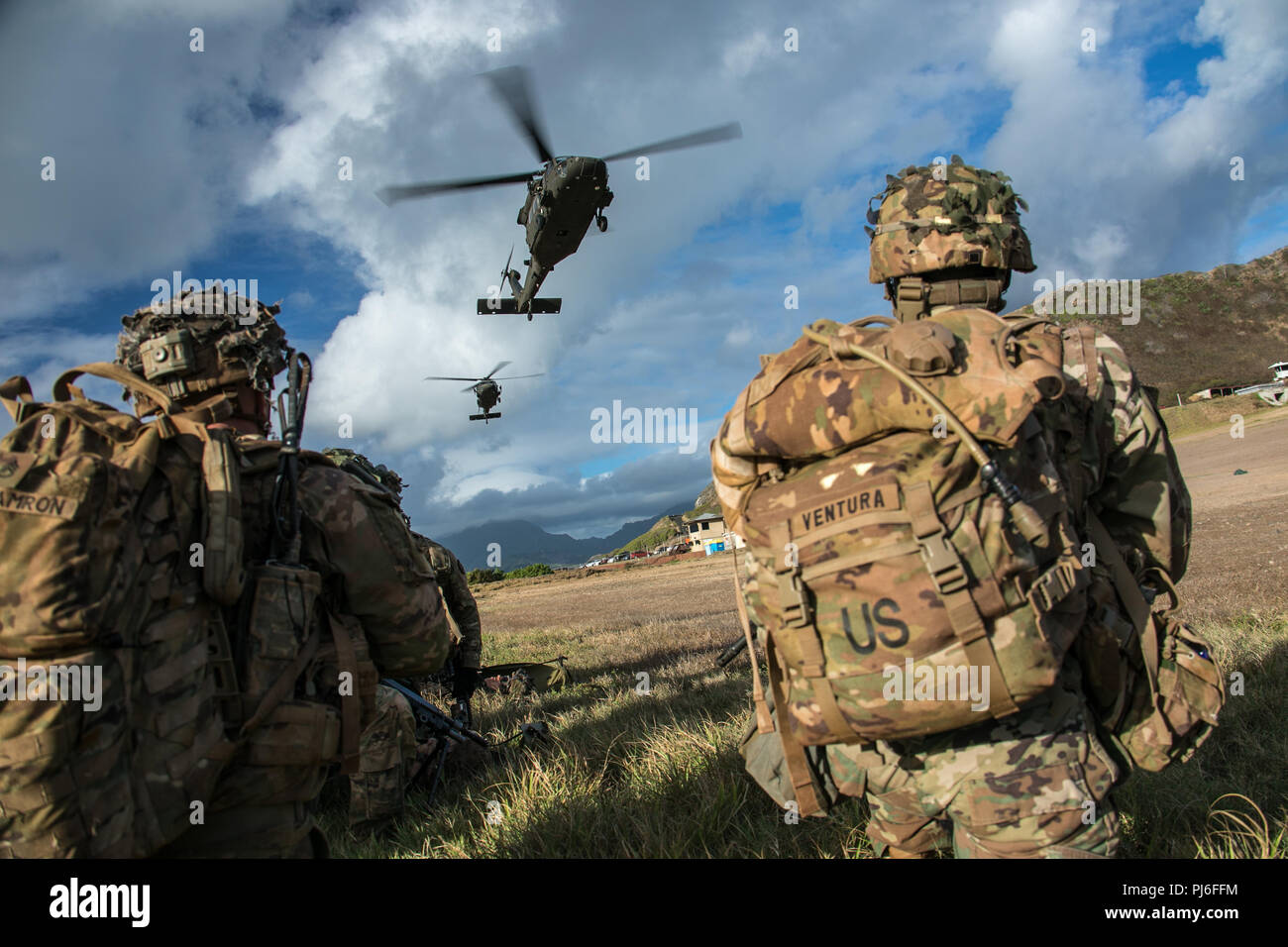 """September 4, 2018 - Marine Corps Base Hawaii, Hawaii, United States - U.S. Army Soldiers assigned to Charlie Co., 1st Battalion, 27th Infantry Regiment """"Wolfhounds"""", 2nd Infantry Brigade Combat Team, 25th Infantry Division, wait for medical evacuation UH-60 Black Hawk helicopters during an air assault training mission on Marine Corps Base Hawaii, Kaneohe, Hawaii, Aug. 21, 2018. The exercise maintains combat readiness in preparation for a Joint Readiness Training Center rotation later this year. (U.S. Army photo by 1st Lt. Ryan DeBooy) www.dvidshub.net U.S. Department of Defense via Stock Photo"""