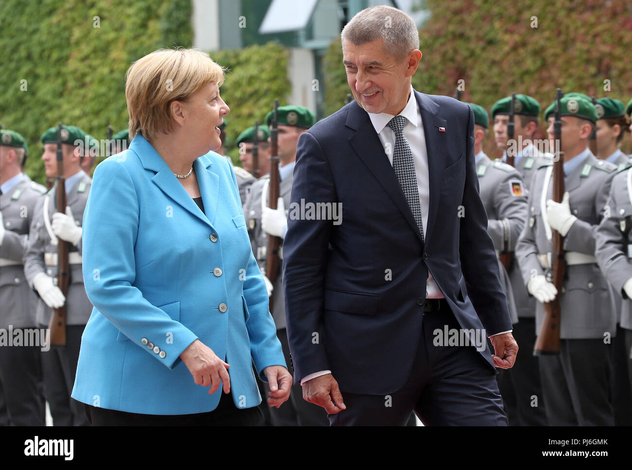 05.09.2018, Berlin: Federal Chancellor Angela Merkel of the Christian Democratic Union (CDU) welcomes the Czech Prime Minister Andrej Babis with military honours before the Federal Chancellery. Photo: Wolfgang Kumm/dpa - Stock Image