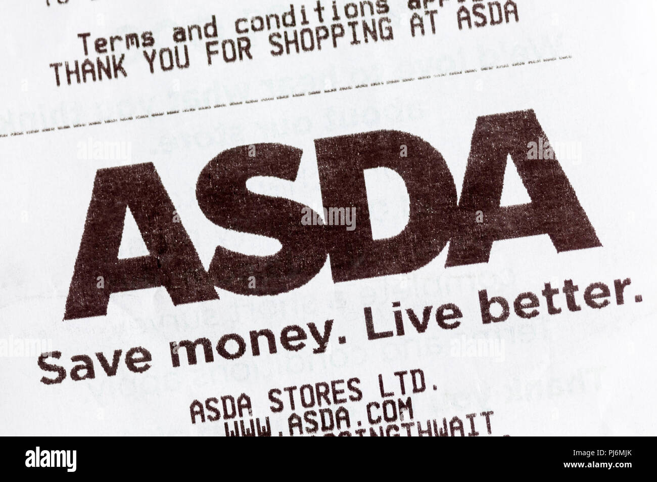 Close-up of Asda Save money Live better slogan printed on a till receipt. - Stock Image