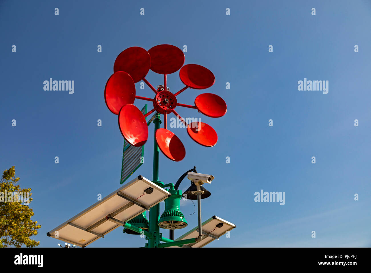 Detroit, Michigan - An artistic windmill at Eastern Market that will generate electricity to power a recharging station for electronic devices. It was - Stock Image