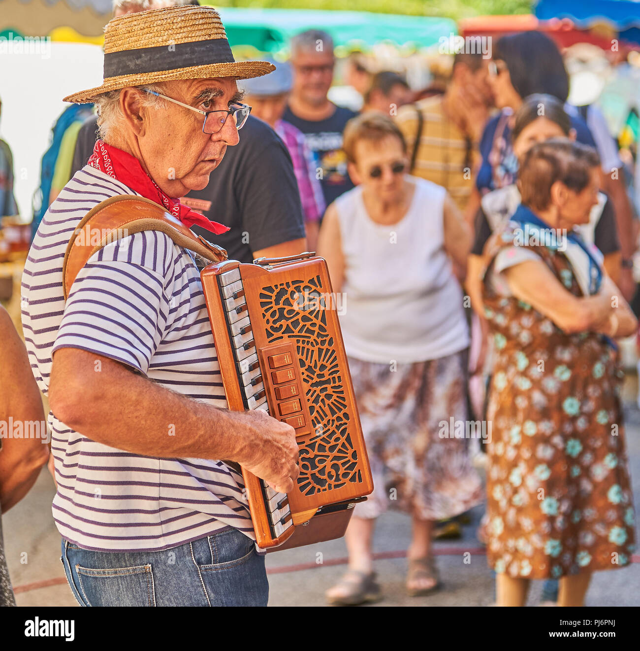 Saint Felicien, Ardeche department of the Rhone Alps and an accordion player entertains people at the cheese festival. Stock Photo