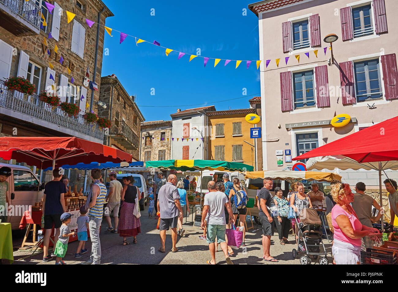 Saint Felicien in the Ardeche department of Rhone Alps, France and street market in the centre of the town Stock Photo