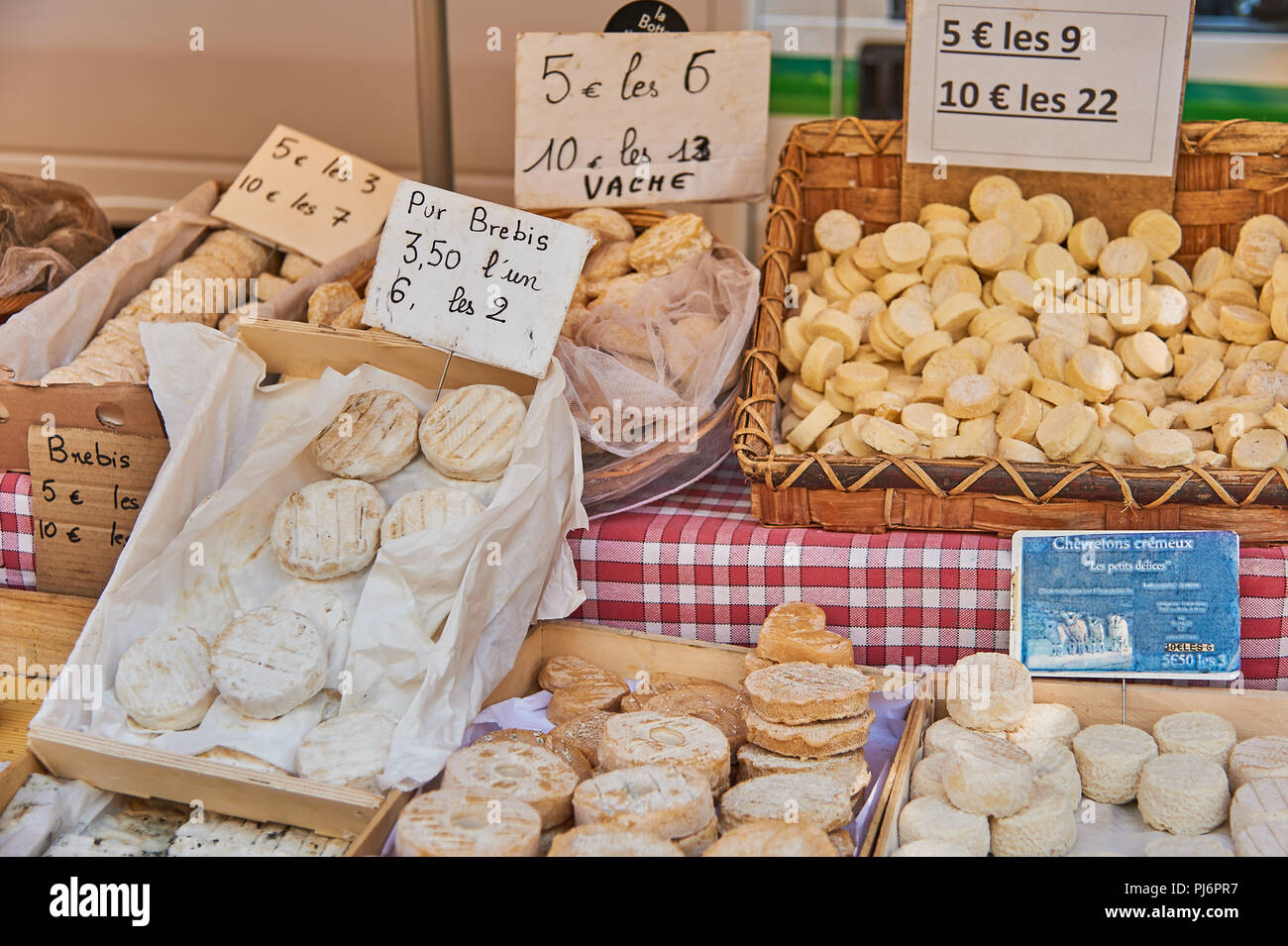 Lamastre, Ardeche, Rhone Alps, France and a market stall selling locally produced cheeses. Stock Photo