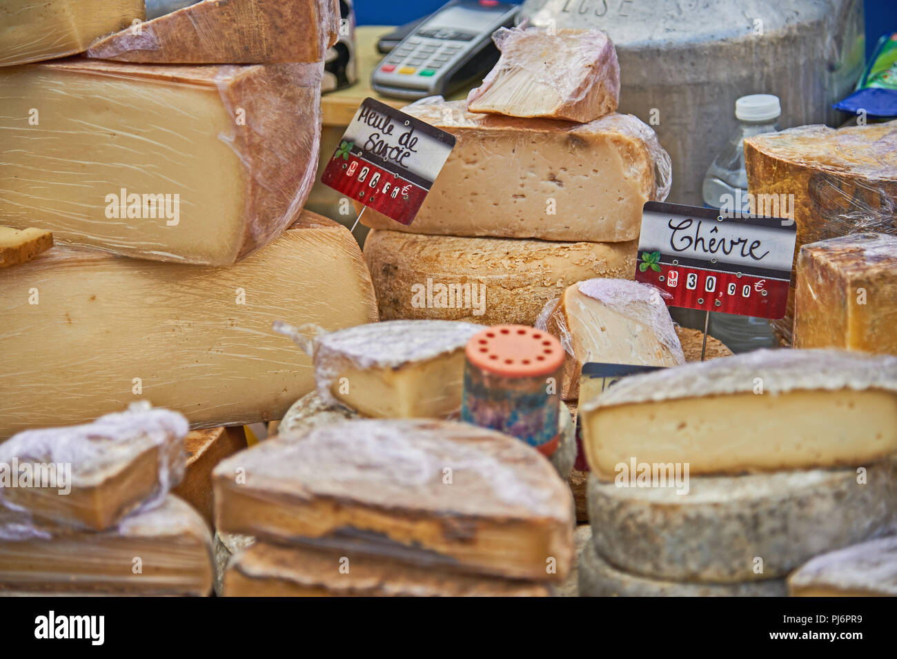 Stall selling cheese at the weekly market in the town of Lamastre, Ardeche, Rhone Alps region of France Stock Photo