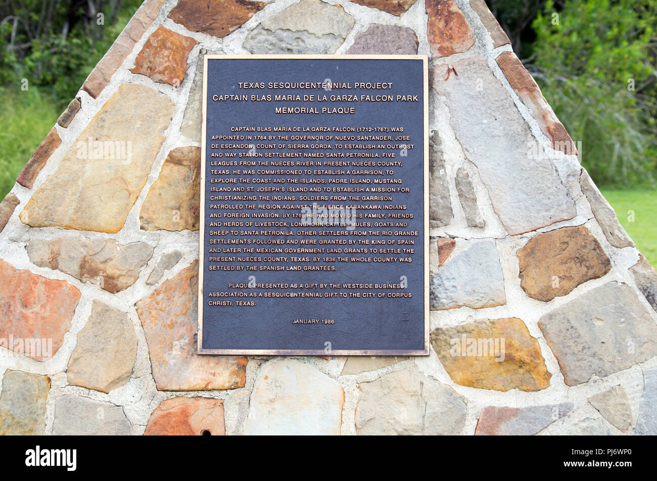 Commemorative plaque in local park describes early settlement of Nueces County, Texas USA by the Spanish. - Stock Image