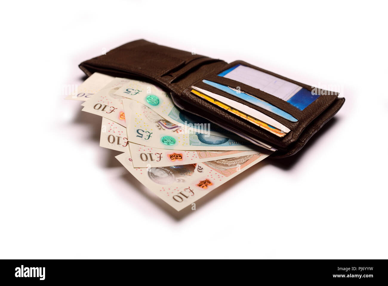 British currency Pound sterling in wallet on white background - Stock Image