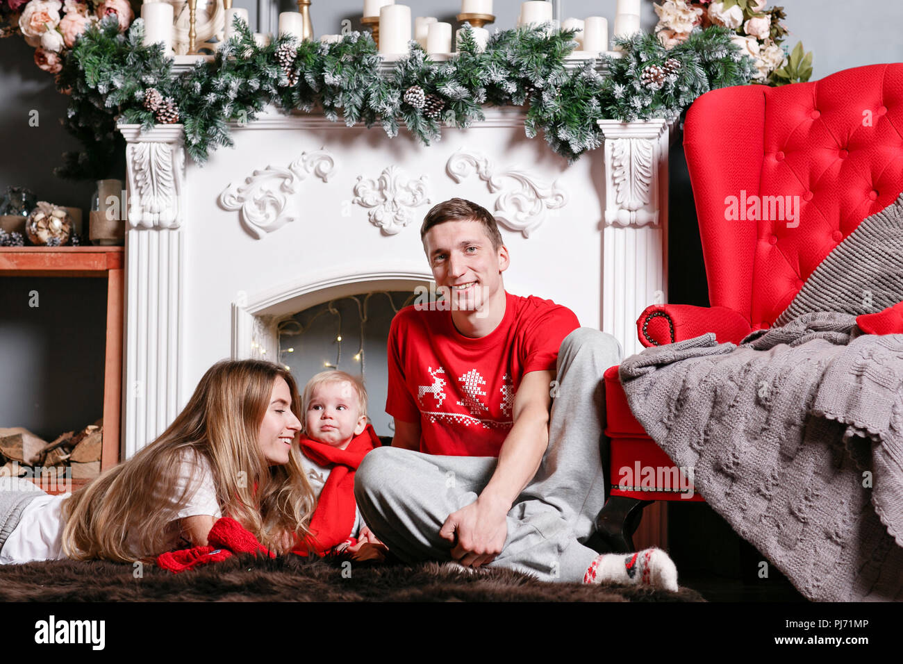 Mom Dad And Little Baby Son Loving Family Merry Christmas And
