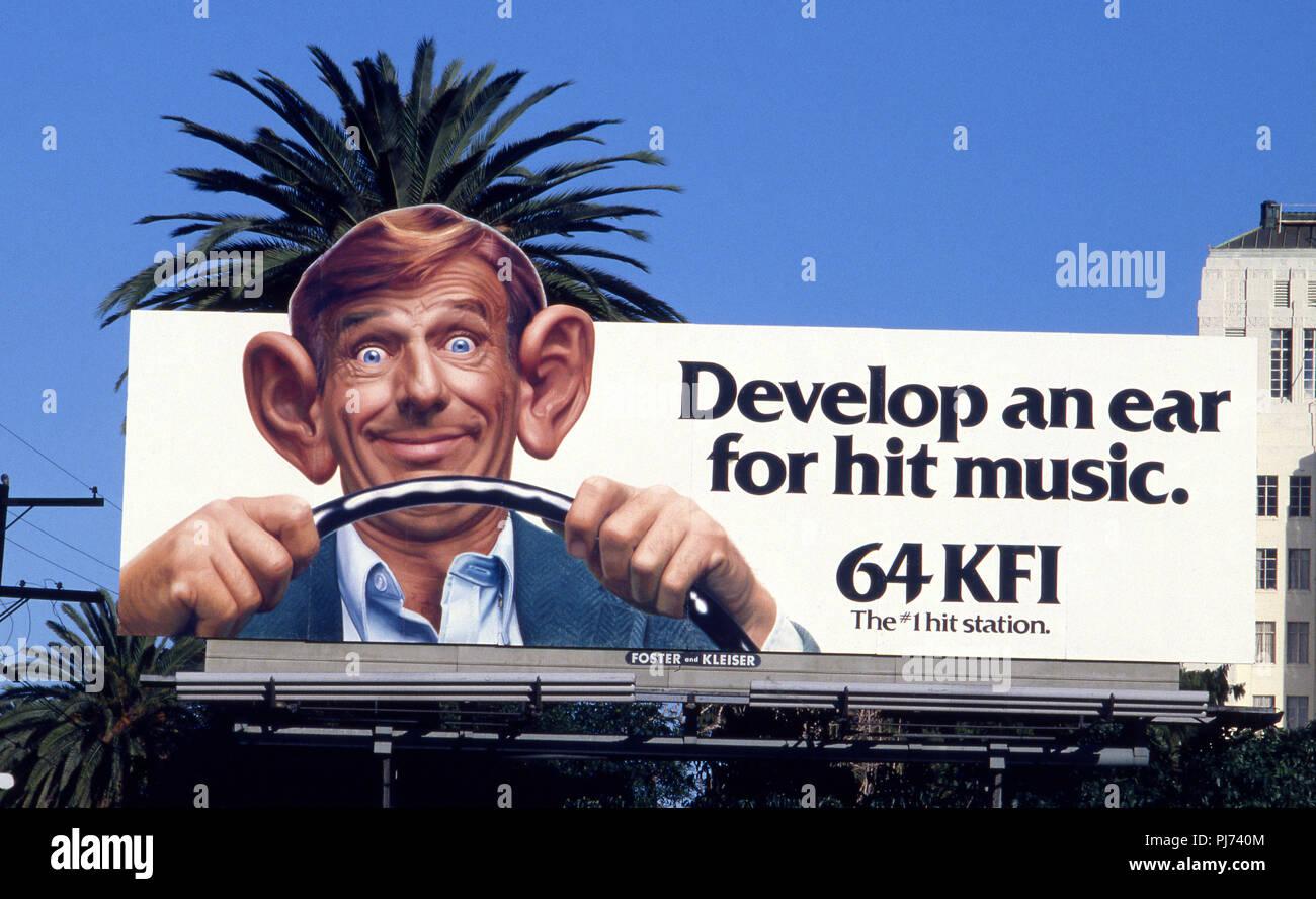 Humorous billboard for radio station KFI in Hollywood circa 1970 - Stock Image