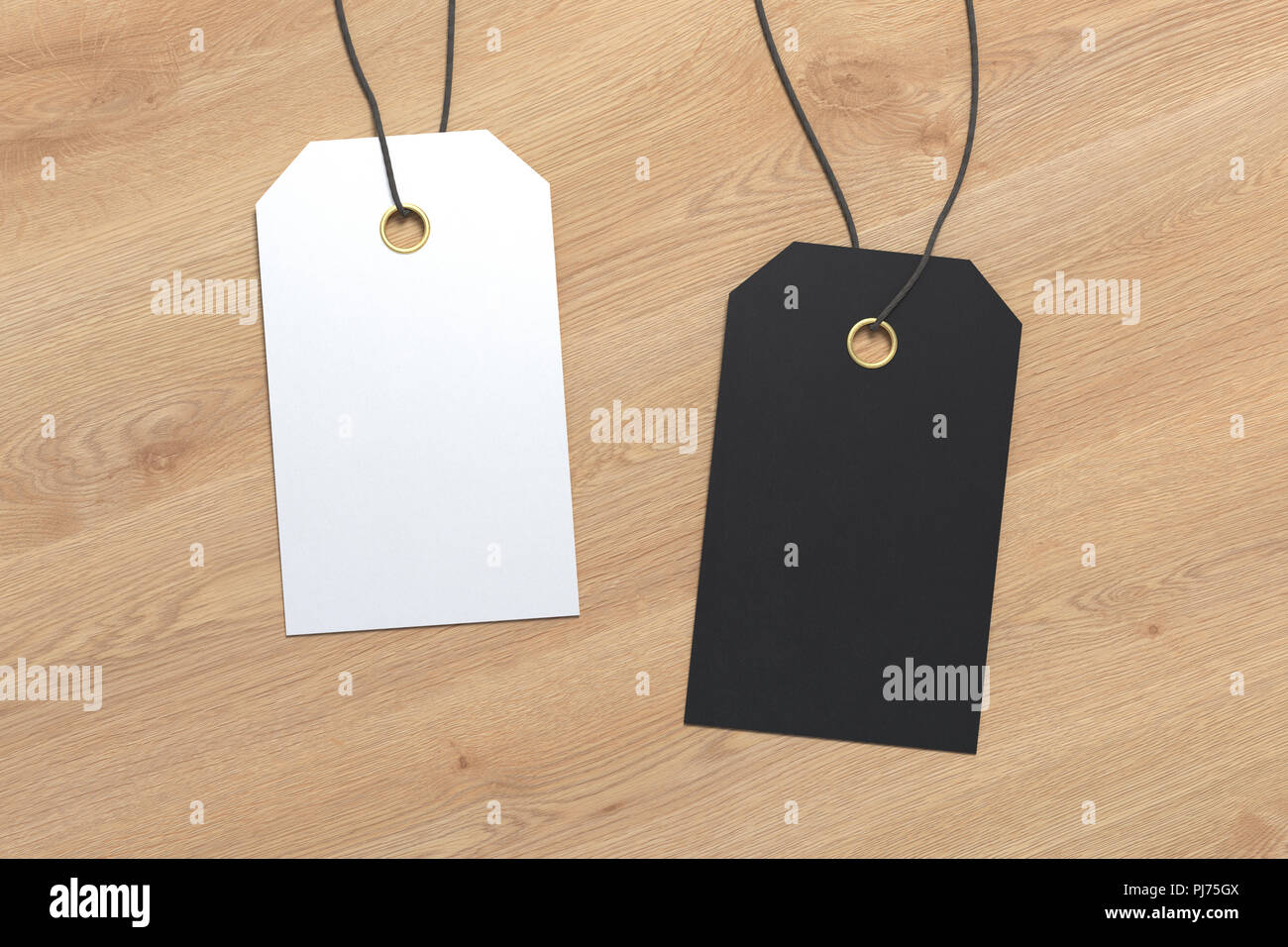 two blank black and white price tag labesl mockup on wooden