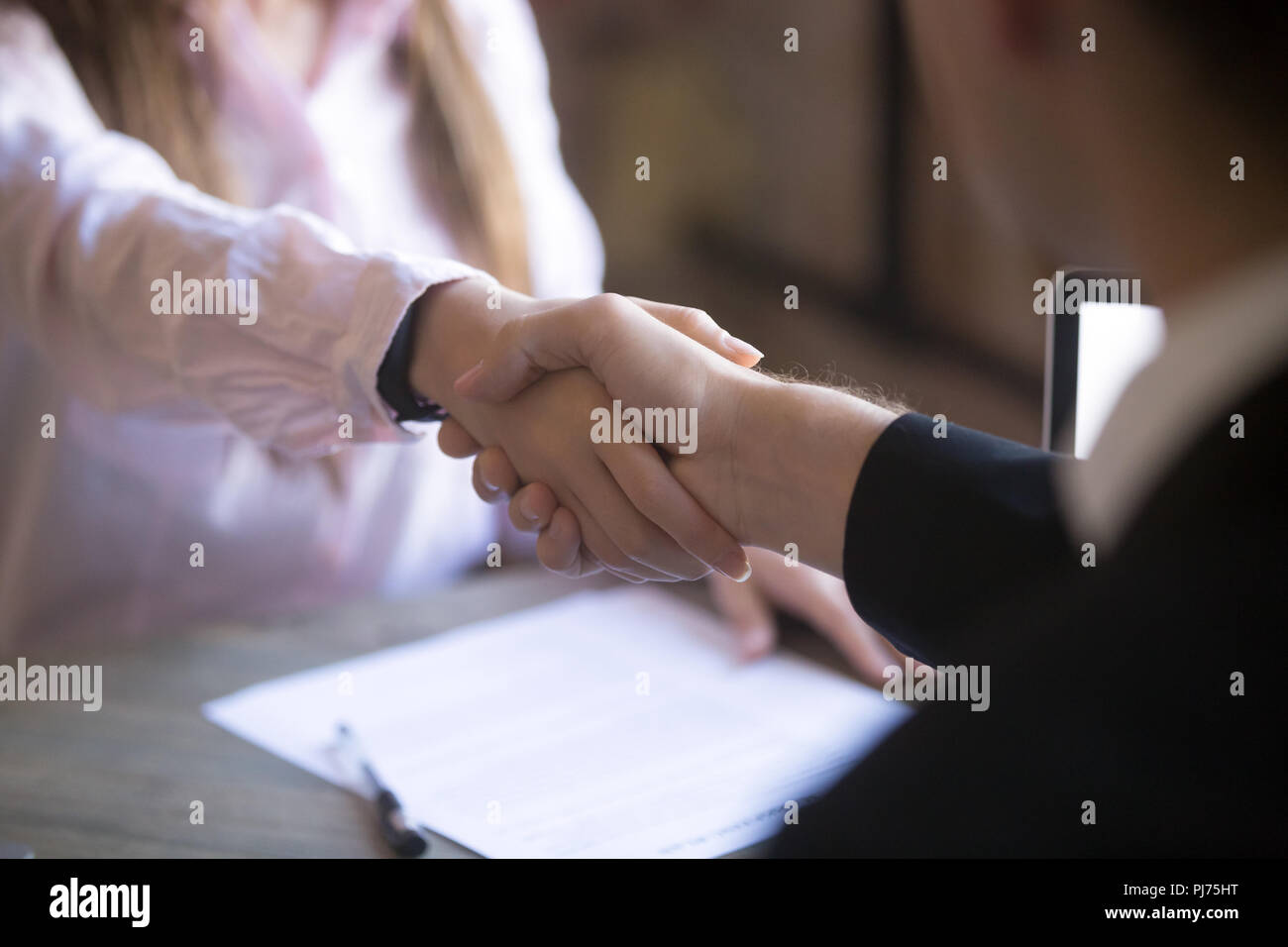 Close up handshake of two successful businesspeople after good deal - Stock Image