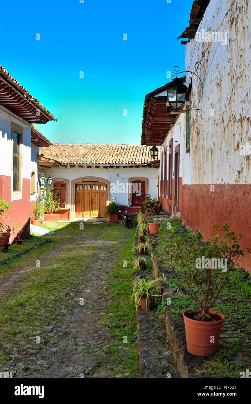 Old rustic street in Patzcuaro, Michoacan, Mexico - Stock Image