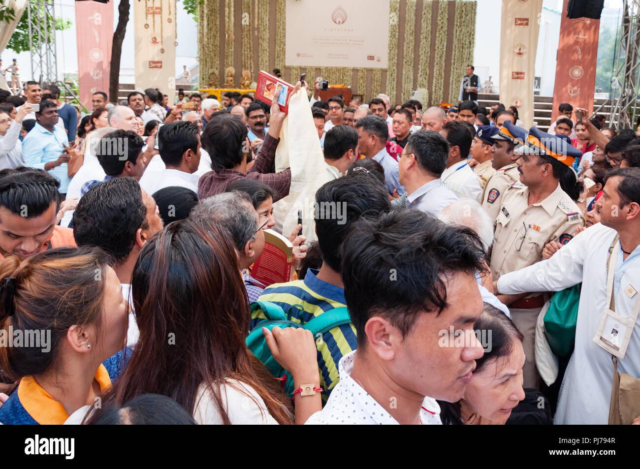 MUMBAI, INDIA – December 10 2017: Crowds jostling to see and photograph the Dalai Lama while policemen look on, as His Holiness the 14th Dalai Lama (B - Stock Image