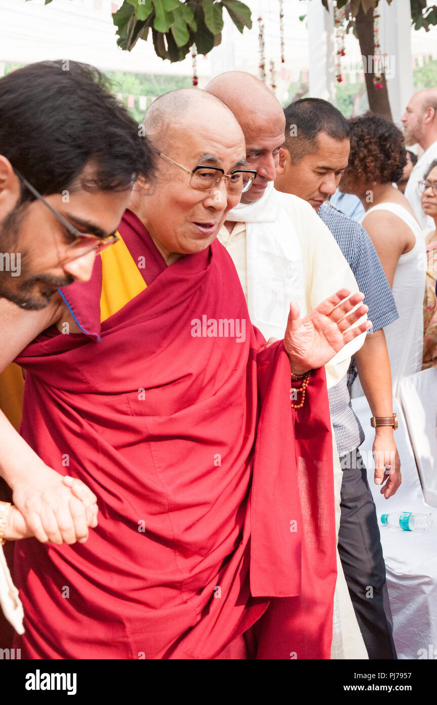 MUMBAI, INDIA – December 10 2017: His Holiness the 14th Dalai Lama waves to people as he is escorted by volunteers at a spiritual lecture event at Som Stock Photo