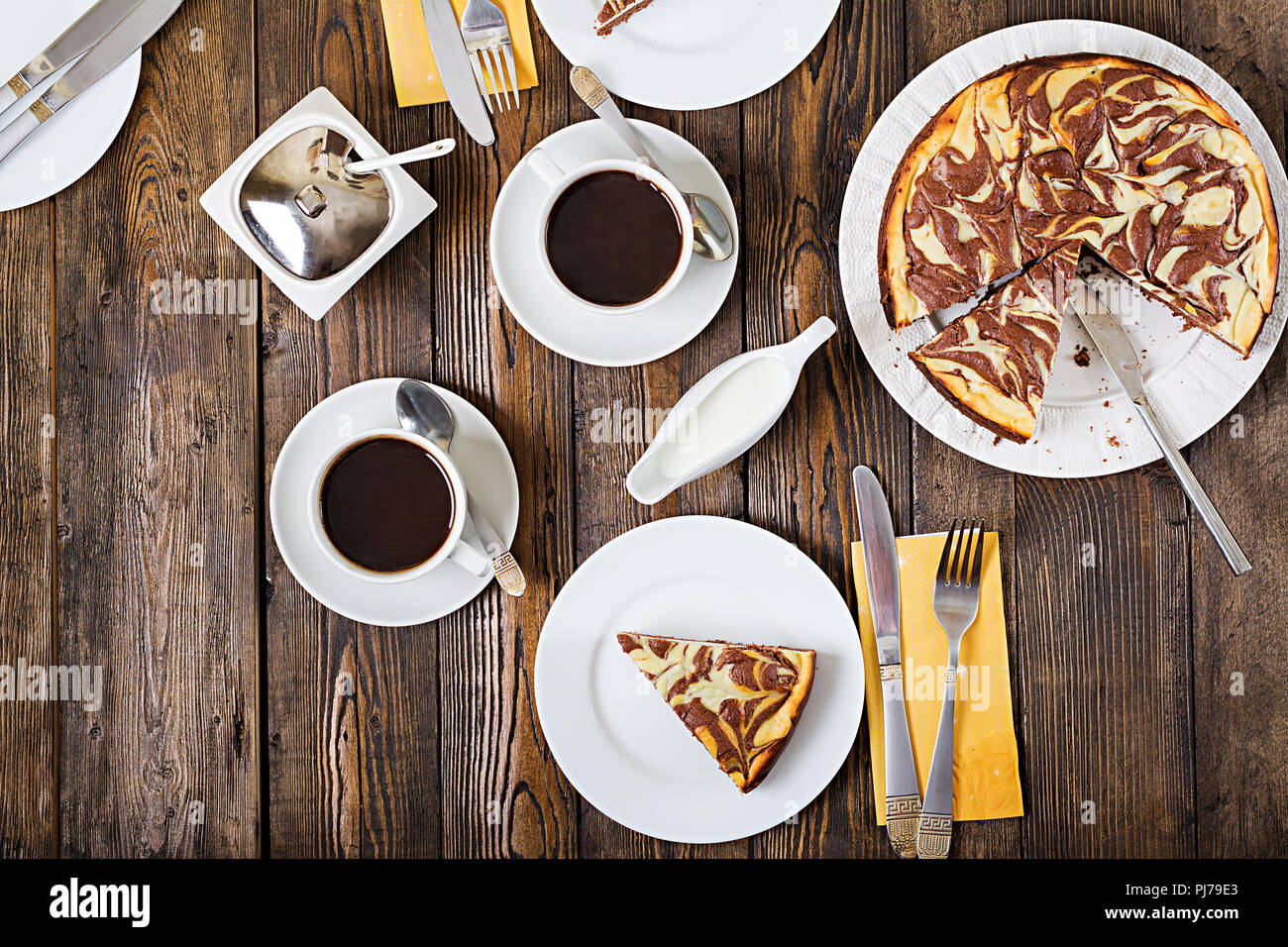 Chocolate cheesecake and coffee on wooden background. Cup coffee and cheesecake.Top view. Flat lay Stock Photo