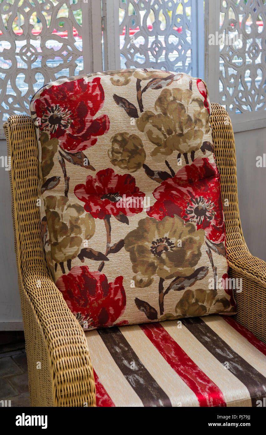 Upholstered wicker chair - Stock Image