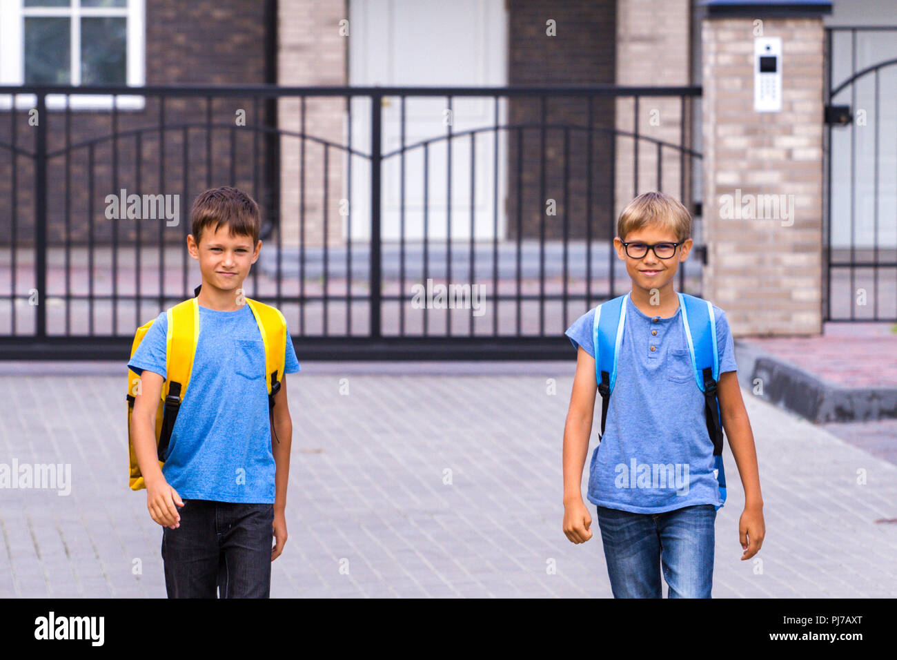 Schoolboys with backpack go to school - Stock Image
