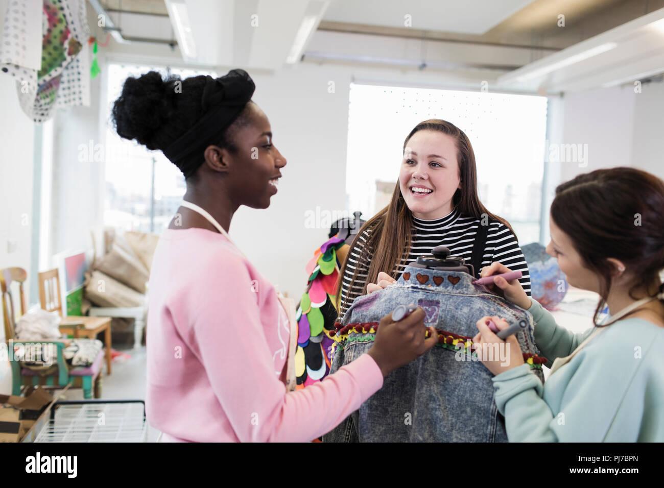 Teenage Girls Designing Denim Jacket In Fashion Design Class Stock Photo Alamy