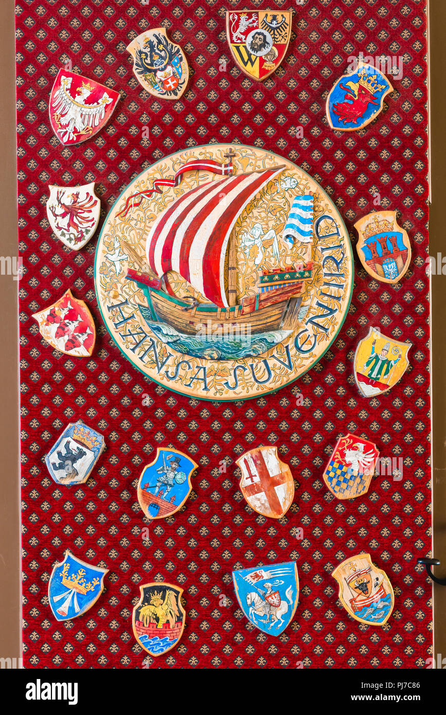 A display in a Tallinn souvenir shop of a large plaque and badges showing the city emblems of members of the Hanseatic (Hansa) League, Tallinn Estonia. - Stock Image