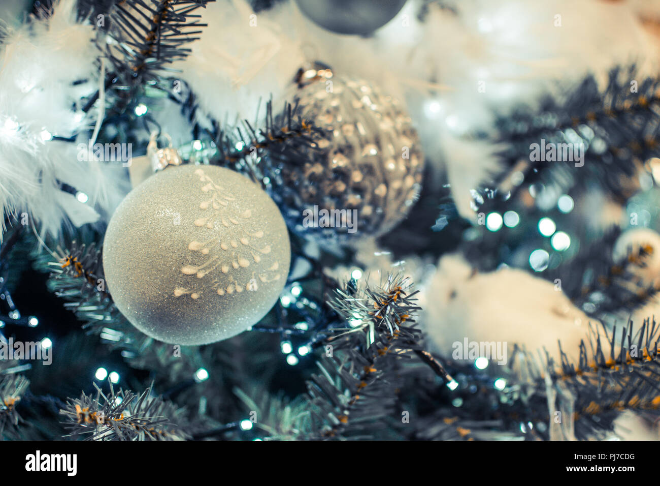 Christmas Tree With Light Green White And Silver Baubles With Feathers And Lights Close Up Selective Focus Stock Photo Alamy